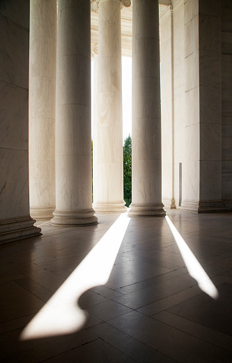Detail of neoclassical white stone memorial in Washington D.C.