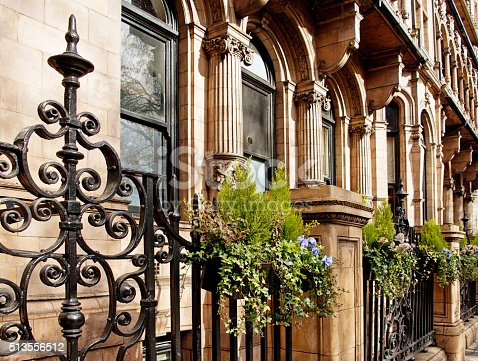 Neoclassical Old English Stonework Facade with Sculpture Pediments