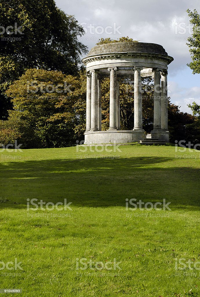 Neoclassical ornamental structure in country estate vertical royalty-free stock photo