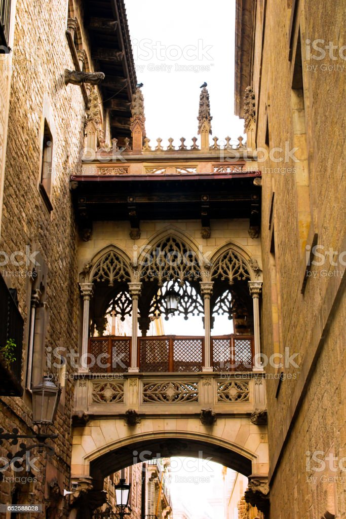 Neogothic-style bridge by architect Joan Rubió was built in 1928 over Carrer del Bisbe, near Placa del Rei and Placa Sant Jaume, in the heart of Barri Gotic. Barcelona, Catalonia, Spain. stock photo