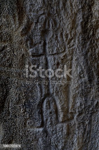 841481956istockphoto Neolithic rock paintings of Gobustan National Park, depicting dancing shaman holding spear in his hand, Azerbaijan,Caucasus,unesco heritage site 1064702374