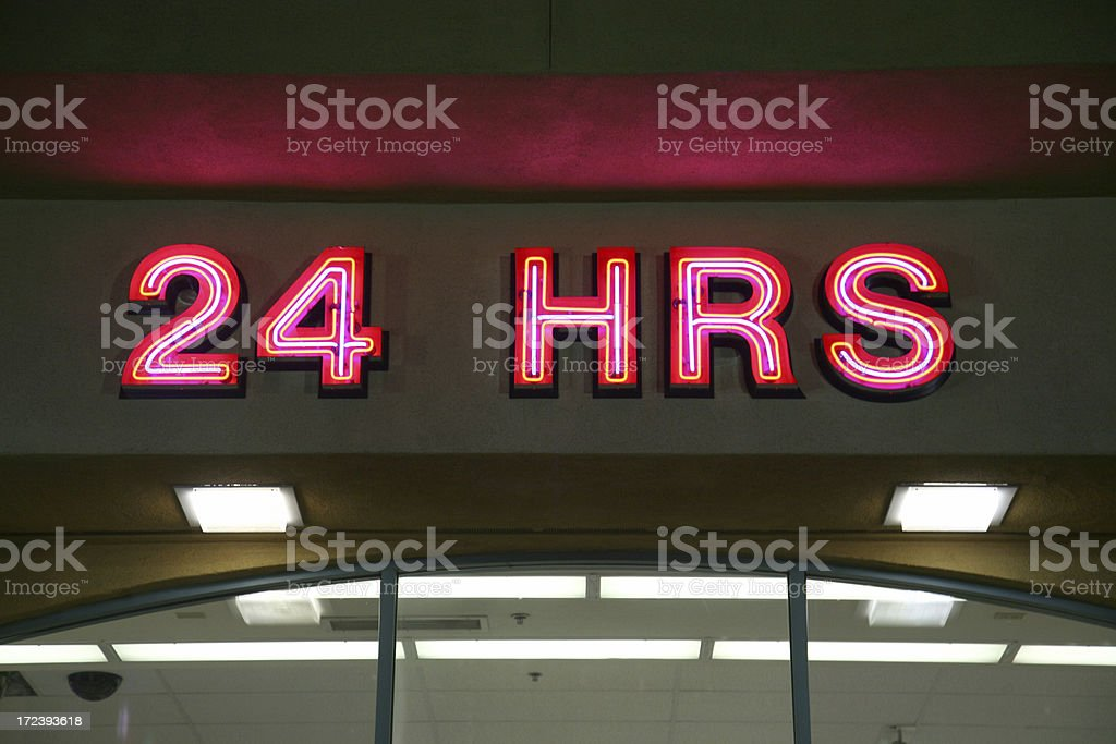 Neon 24 Hours Sign stock photo