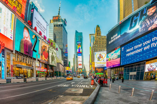 neon advertising of News, brands and theaters at times square in late afternoon stock photo