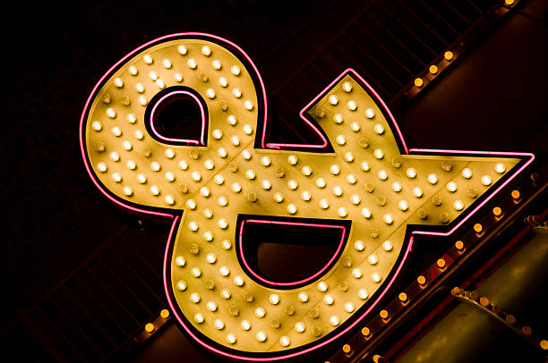 neon ampersand sign - ampersand stock pictures, royalty-free photos & images