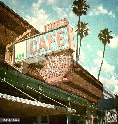 aged and worn neon cafe sign with palm trees