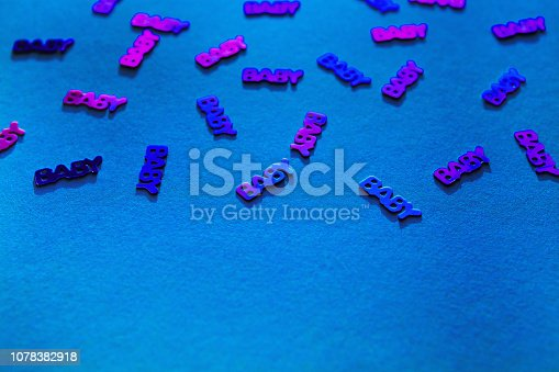 875685464istockphoto Neon coloured confetti baby on blue background 1078382918