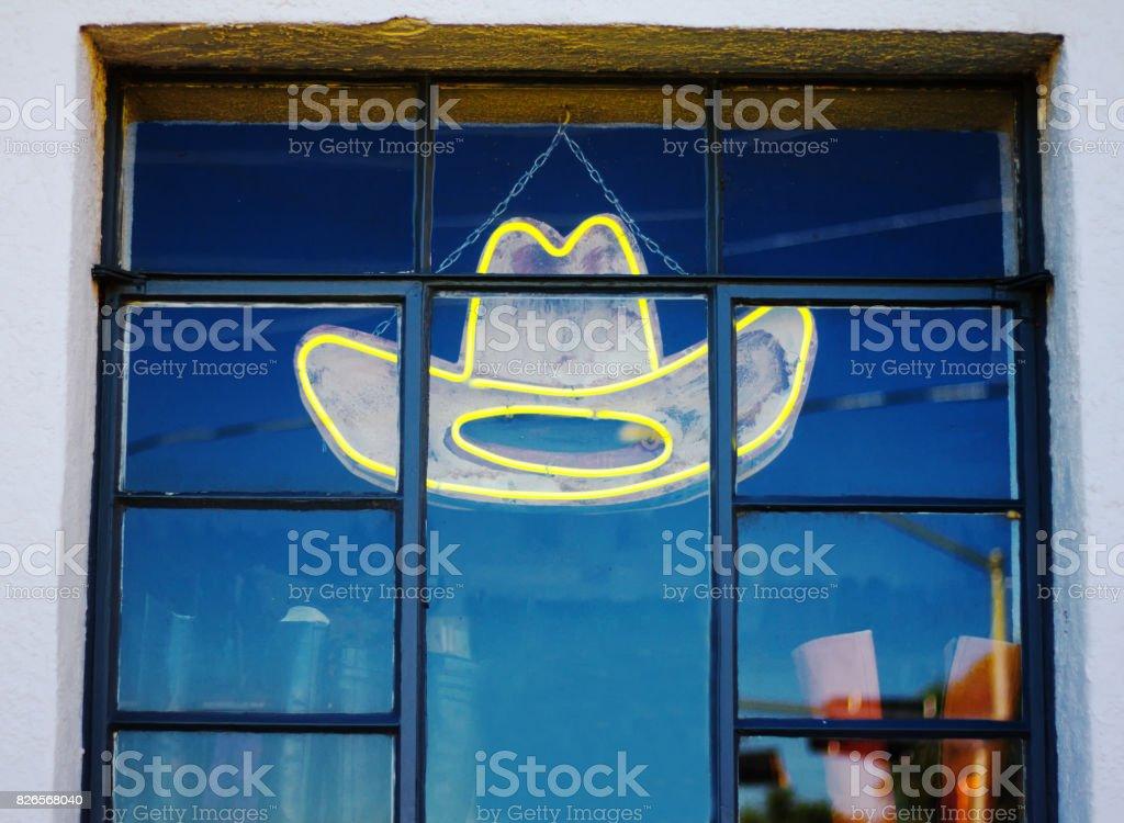 Neon Cowboy Hat in Shop Window stock photo