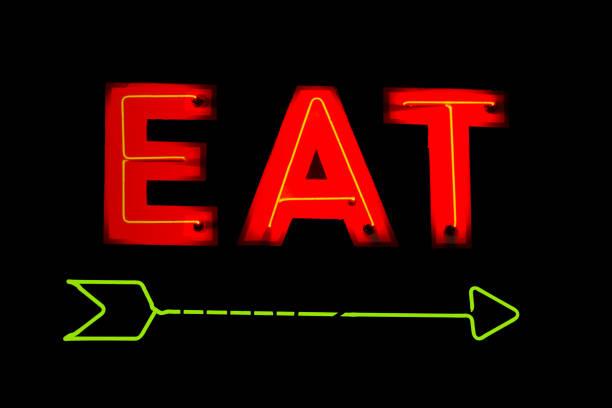Neon Eat Restaurant Sign stock photo