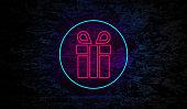istock Neon Gift Box icon on Brick Wall 1190118757