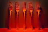 Neon glow - Orange forks in a row