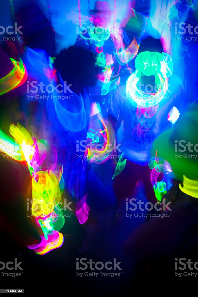 Neon Glow Party Crowd stock photo