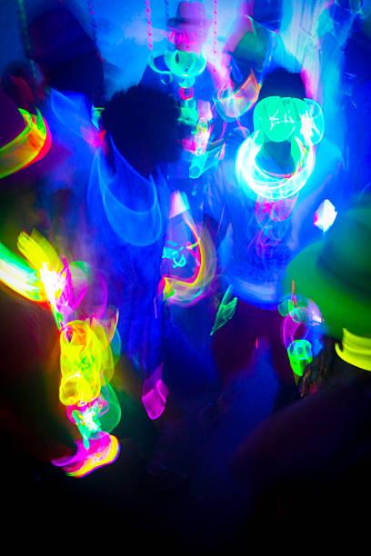Neon Glow Party Crowd stock photo
