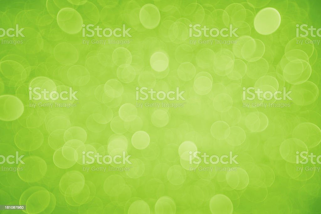 Neon green blurred sparkles and circles stock photo