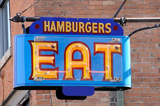 Neon Hamburgers Eat Sign Outside Fast Food Dive Resteraunt, Americana stock photo