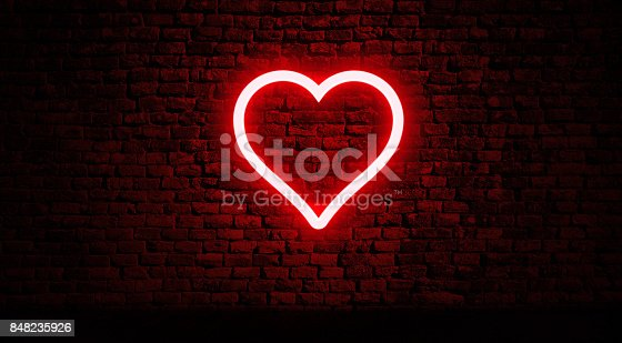 istock Neon heart on brick wall 848235926