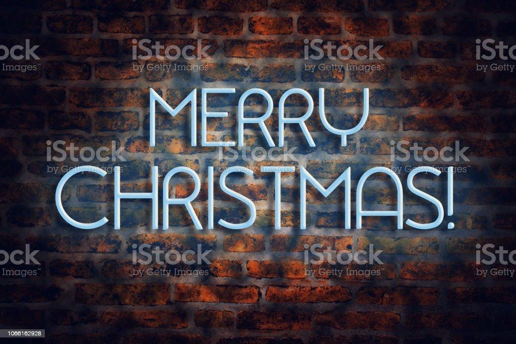 Schriftzug Frohe Weihnachten Beleuchtet.Neon Schriftzug Frohe Weihnachten Auf Einer Gemauerten Wand