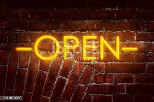 511875398 istock photo Neon inscription Open against the background of the old brick wall. Advertising. 1031910092