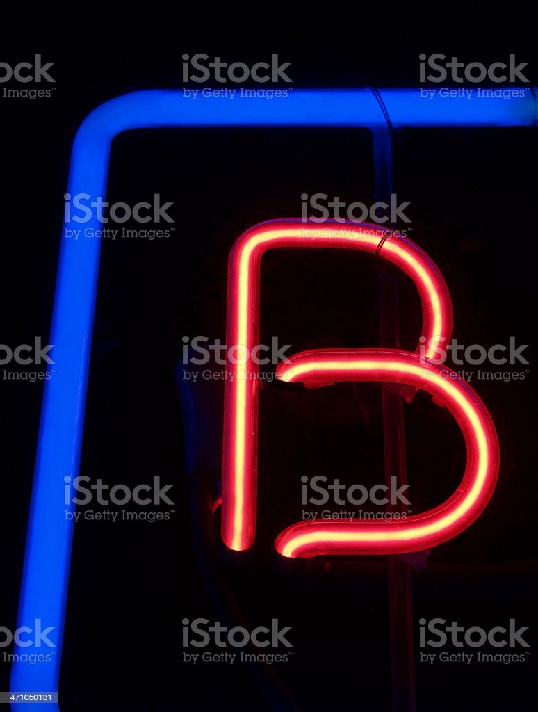 Neon Letter B; Retro Red and Blue Sign at Night stock photo