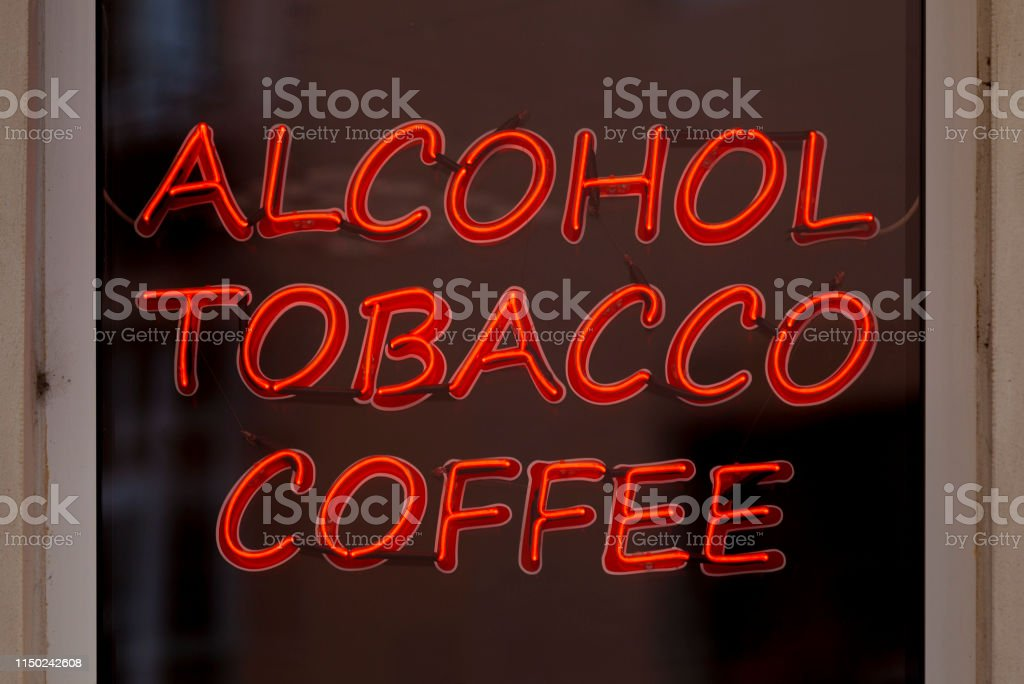 Neon light - Alcohol, Tobacco, Coffee stock photo