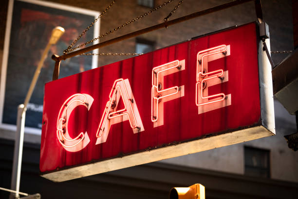 Neon light bulb cafe coffee shop sign stock photo