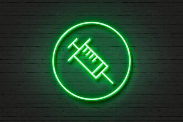 neon light icon needle health - flu shot zdjęcia i obrazy z banku zdjęć