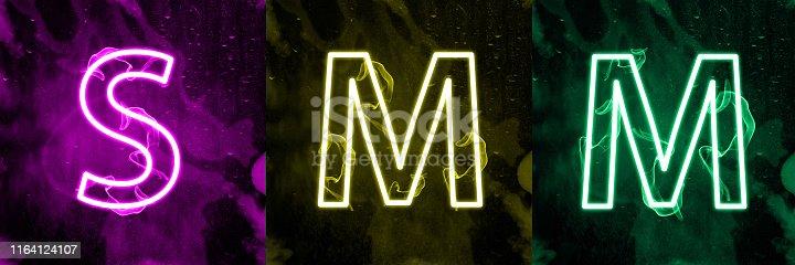 istock Neon light lettering of modern social media's term 1164124107