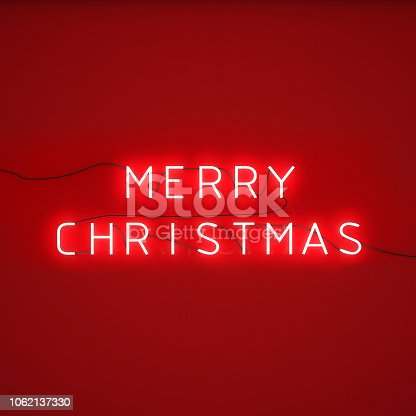 istock LED neon light on wall, Merry Christmas alphabet 1062137330