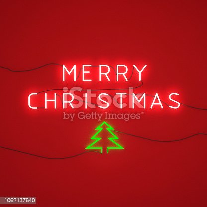 istock LED neon light on wall, Merry Christmas alphabet 1062137640