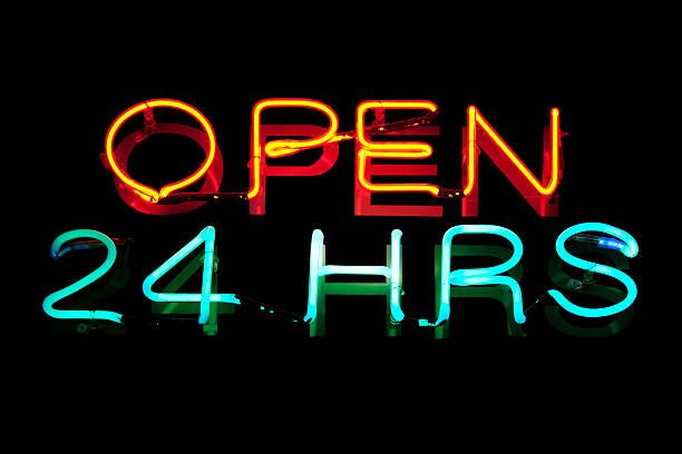 Neon light : open 24 hours stock photo