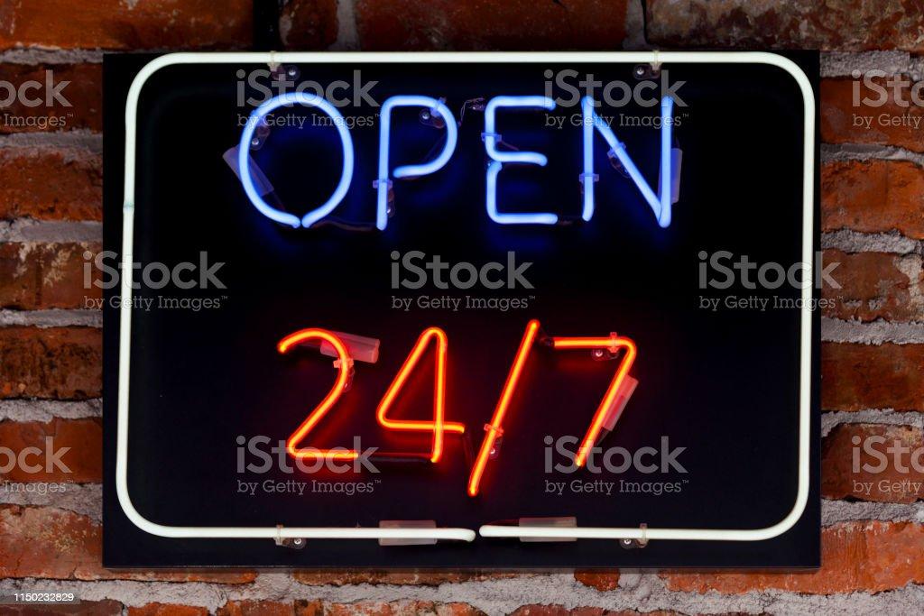 Neon light - Open 24/7 stock photo