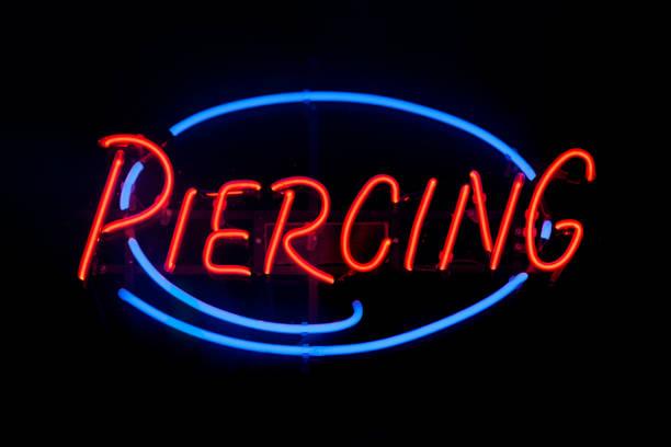 Neon light - Piercing stock photo