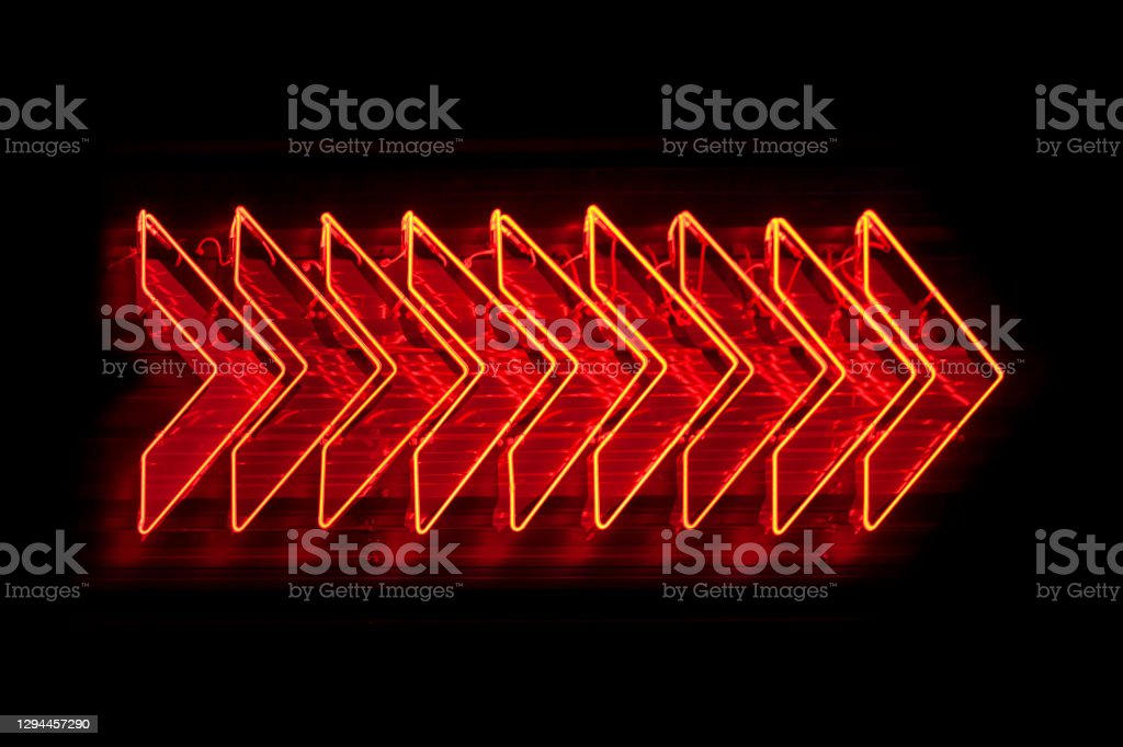 Neon light - Red arrows Set of red arrows neon light pointing right. Arrow Symbol Stock Photo