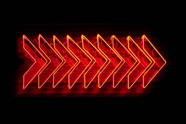 Neon light - Red arrows stock photo