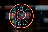 Close-up on a neon light shaped into a circle with written inside \