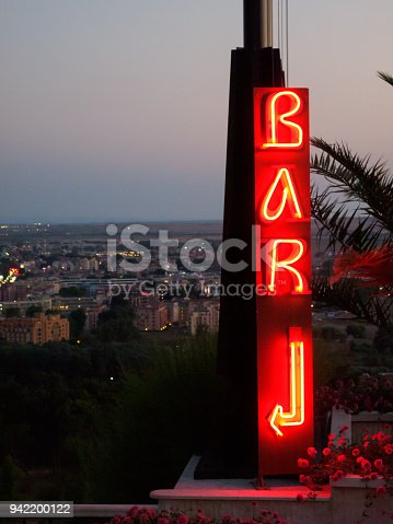 istock Neon lit BAR sign with arrow 942200122