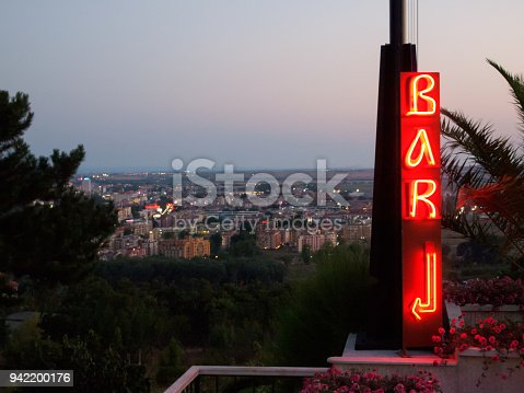 istock Neon lit BAR sign with arrow 942200176