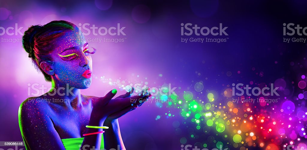 Neon Model Blowing Spectrum Lights stock photo