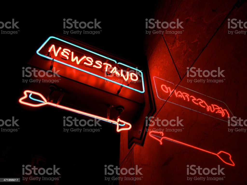 Neon News Stand Sign from Below with Arrow and Reflection royalty-free stock photo