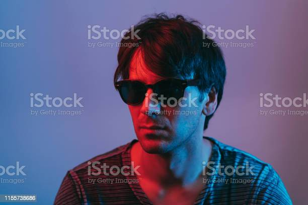 Neon portrait of young man with sunglasses