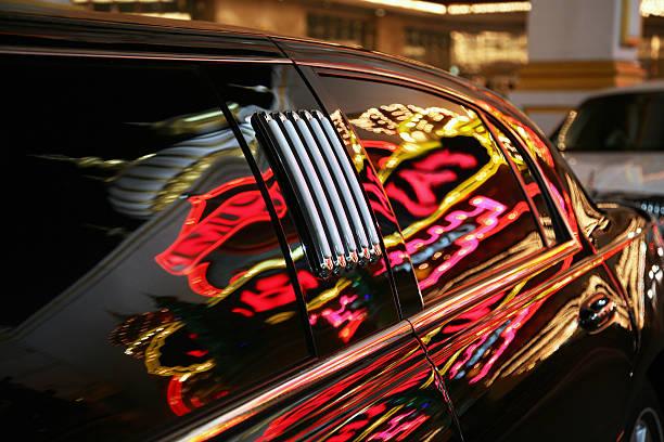 Neon Reflections On Limosine Window stock photo