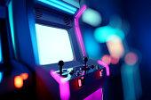 istock Neon Retro Arcade Machines In A Games Room 1300036832
