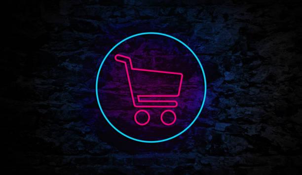 Neon Shopping Cart Sign on Brick Wall stock photo