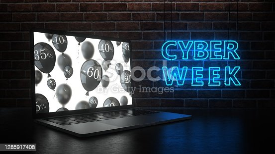 A notebook on the table and neon sign Cyber Week on the brick wall. 3d illustration.