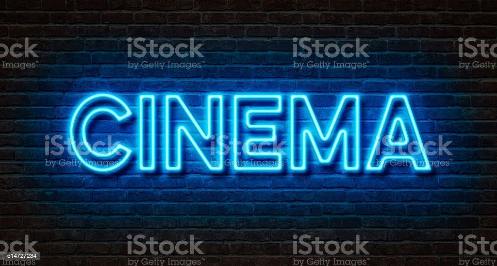 Neon sign on a brick wall - Cinema stock photo