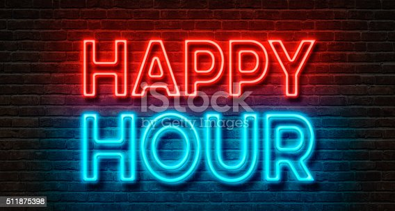 istock Neon sign on a brick wall - Happy Hour 511875398
