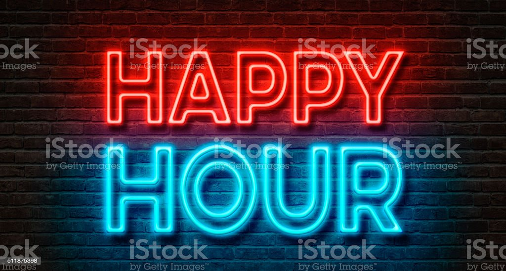 Neon sign on a brick wall - Happy Hour stock photo