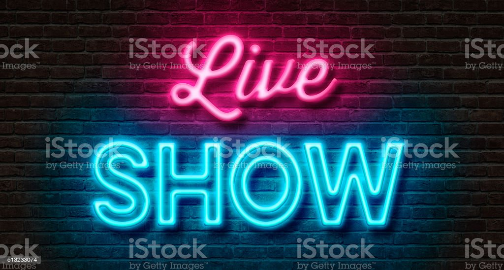 Neon sign on a brick wall - Live Show stock photo