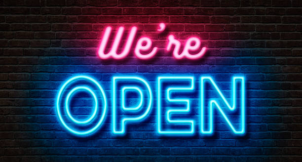 neon sign on a brick wall - we are open - neon stock photos and pictures