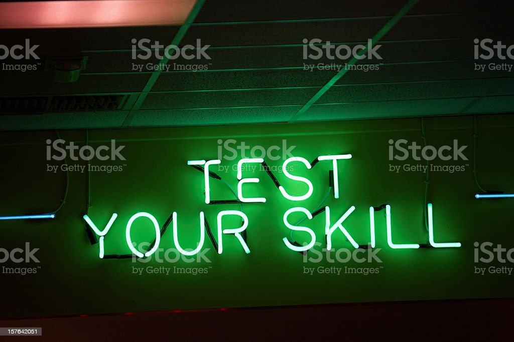 Neon sign showing test your skill royalty-free stock photo