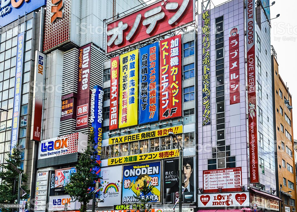 Neon signs and train in Akihabara stock photo